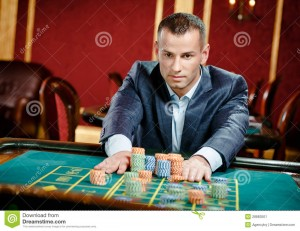 http://www.dreamstime.com/stock-image-gambler-placing-bet-roulette-table-image28883501